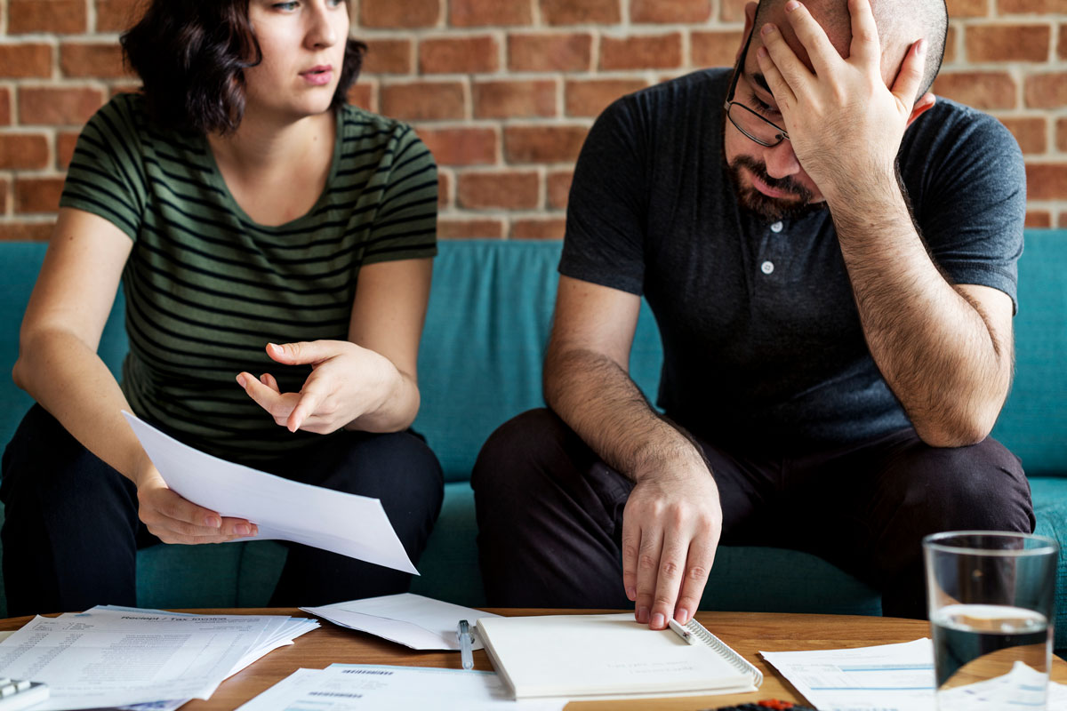 Couple overwhelmed with bills