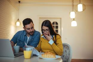 Couple reviewing credit scores