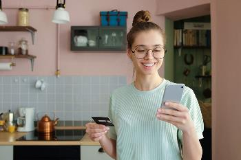 Excited woman looking at phone