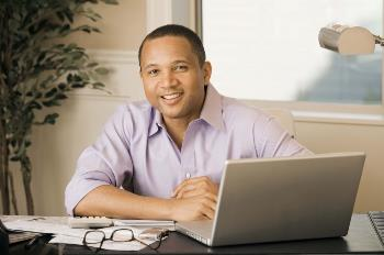 man in front of laptop