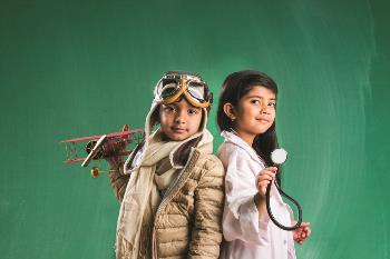 Boy and girl dressed up as a pilot and doctor