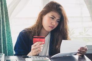 Woman looking over credit card statement