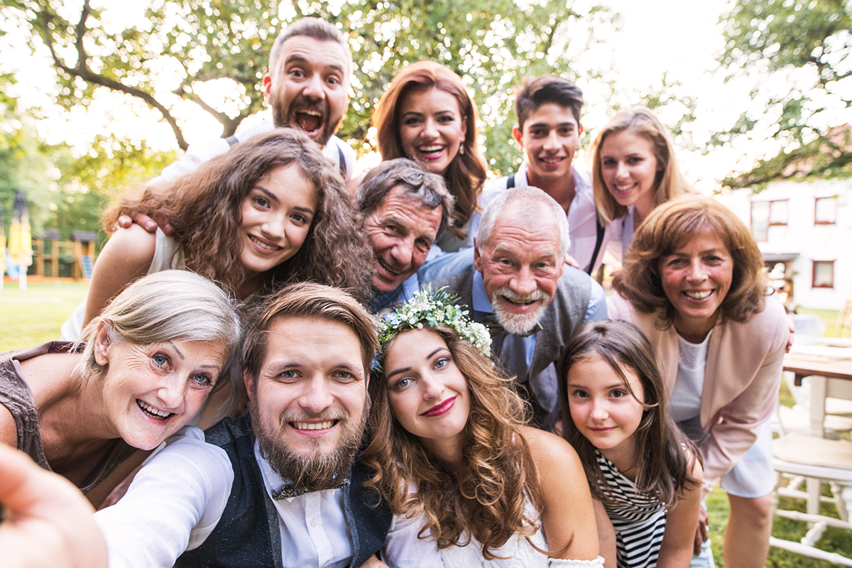 family selfie at a wedding