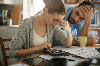 couple concerned about organizing their finances