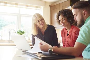 couple getting finances ready for home purchase