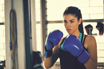 Young women boxing with gloves on