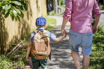 father-walking-son-to-school