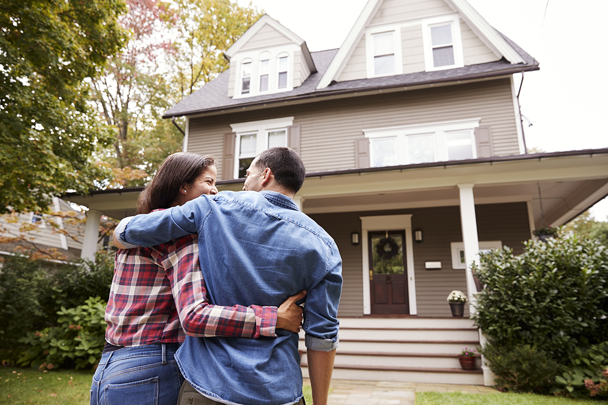 happy couple selling house