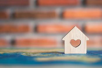 Small wooden home token with a heart in the middle