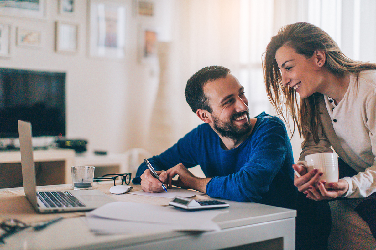 husband and wife researching banking options