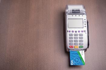 ihmvcu chip debit card in chip reader terminal