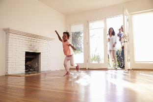 little girl running in new home