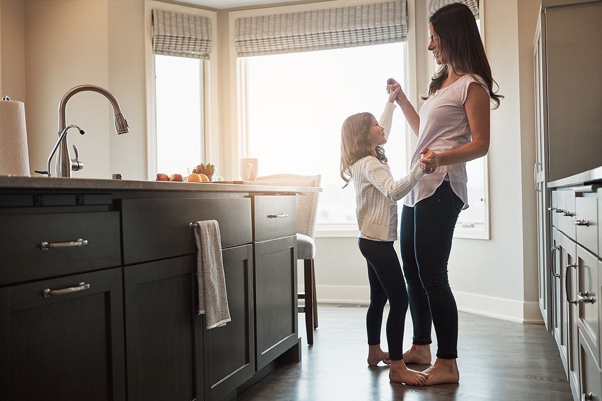 stay at home mom in the kitchen with daughter
