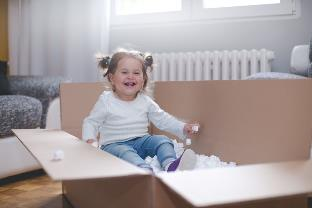 cute baby girl in moving box
