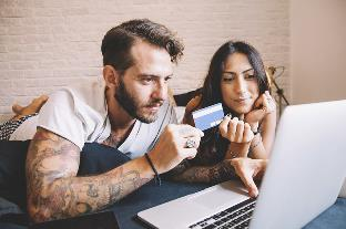 young couple checking credit