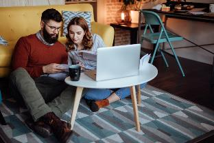 young couple reading financial to do list