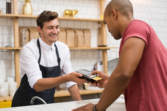 Business owner accepting credit card payments
